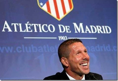 Atletico de Madrid's new soccer coach Diego 'Cholo' Simeone gestures during his official presentation at the Vicente Calderon stadium in Madrid, Spain, Tuesday, Dec. 27, 2011. (AP Photo/Andres Kudacki)
